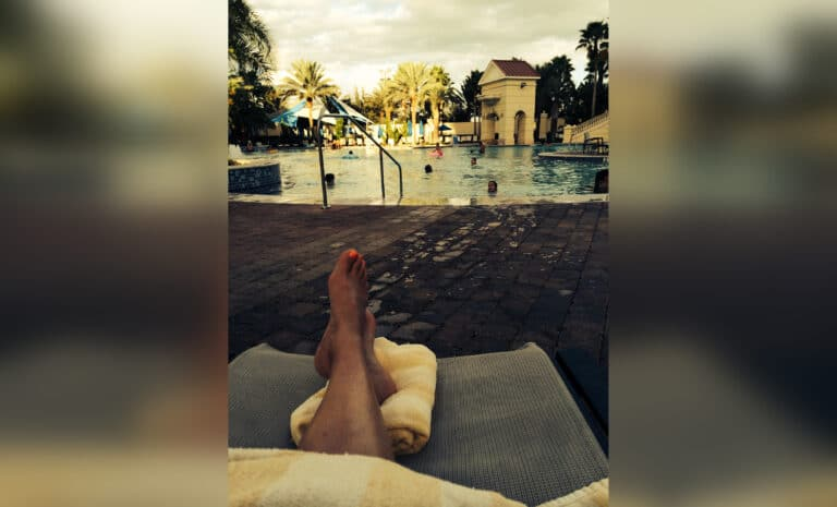 Woman's feet on vacation by pool