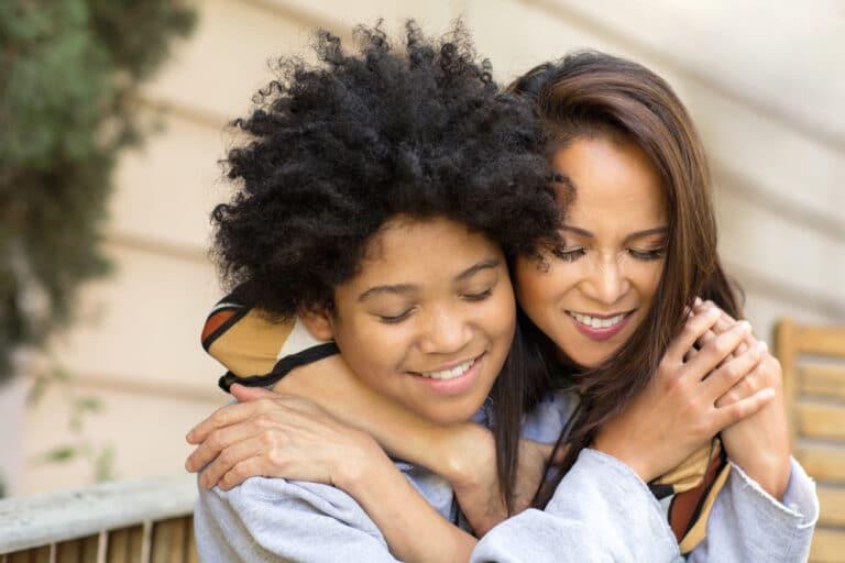 Mother and child hug