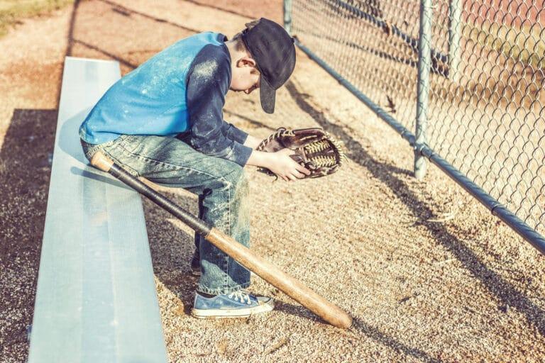 Baseball player on bench sad