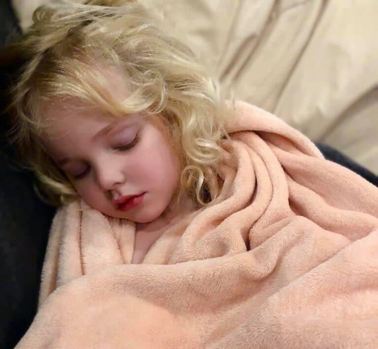Little girl sleeping, color photo
