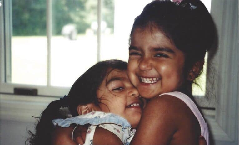 Two smiling young sisters