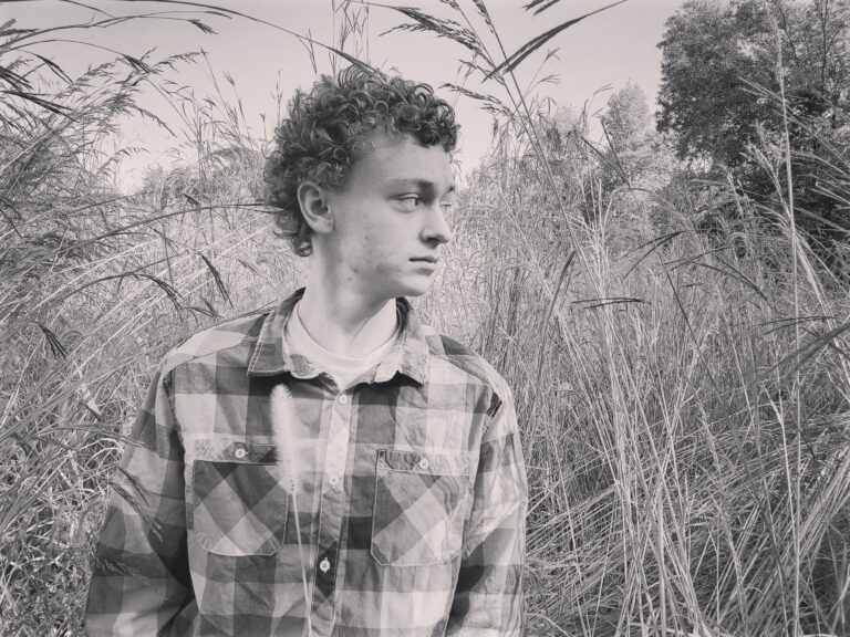 black and white photo of teen boy