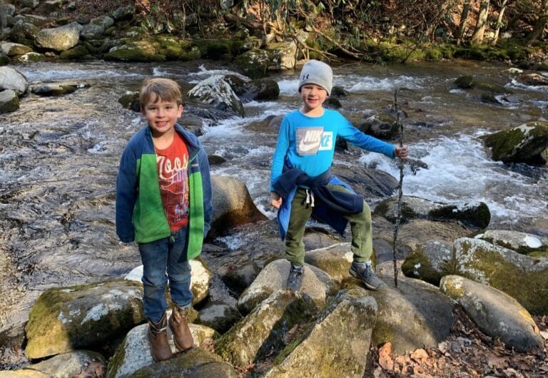 Two boys outside on rocks
