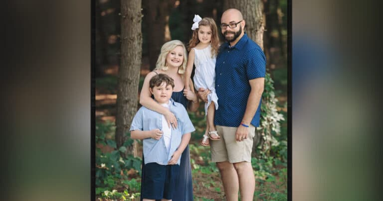 Husband, wife, two children, color photo