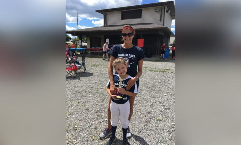 Mother and daughter at softball game, color photo