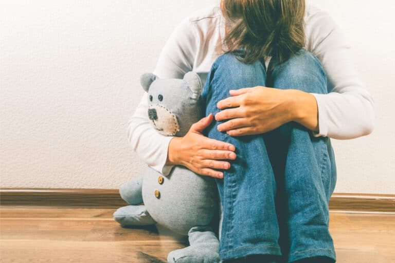 Woman hugging teddy bear