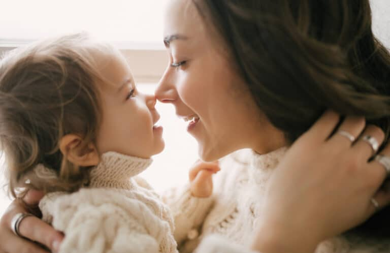 Mom touching noses with child