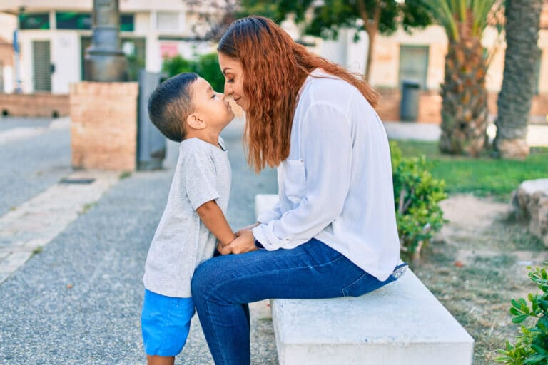 Mom touching noses with son