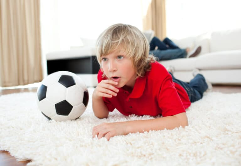 Boy watching soccer