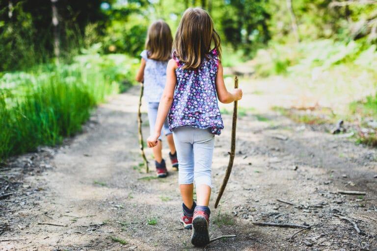 Two girls walking down road