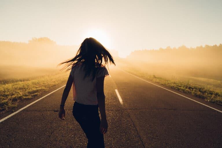 Girl walking down road