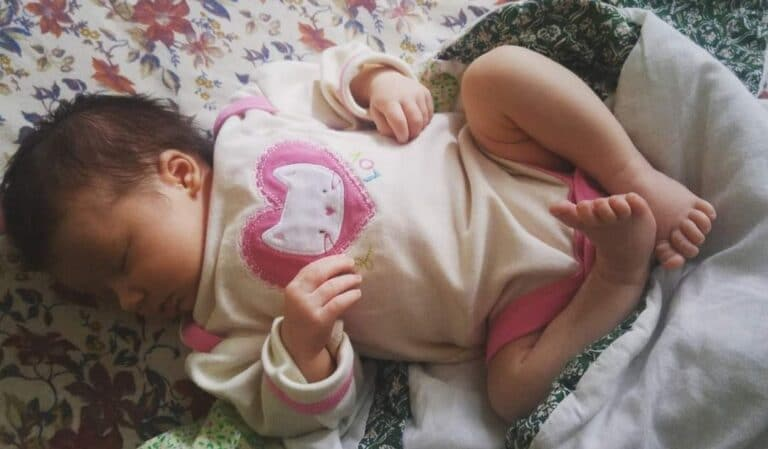 Infant sleeping, color photo