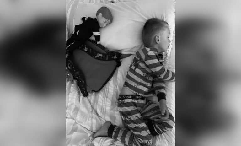 Little boy sleeping, black and white photo