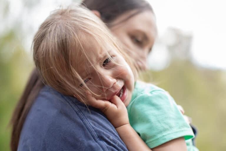 Mom holding crying child