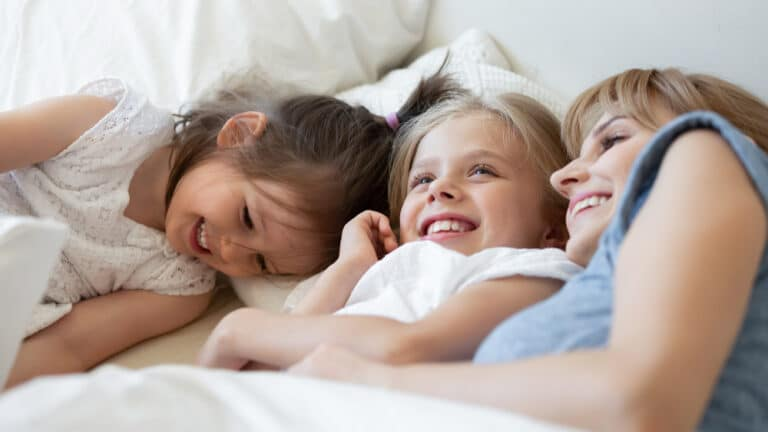 Mom with two daughters smiling