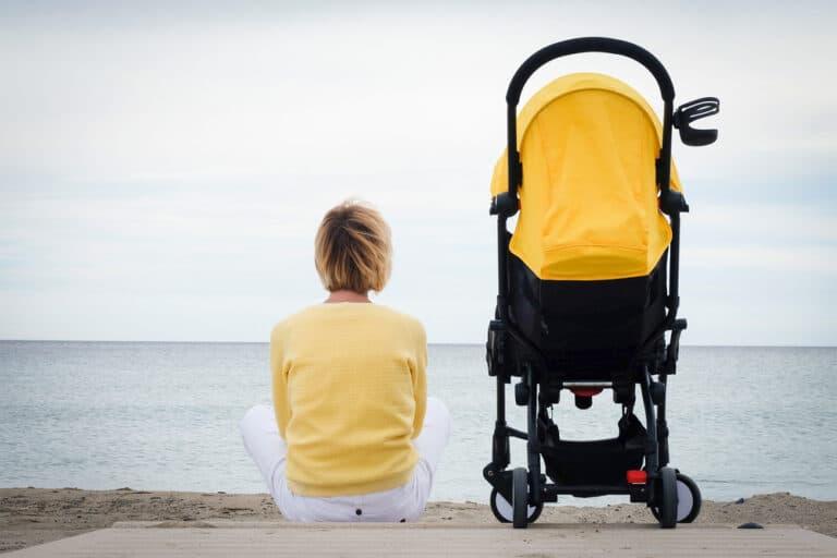Woman sitting by stroller