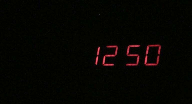 Digital clock reading 12:50