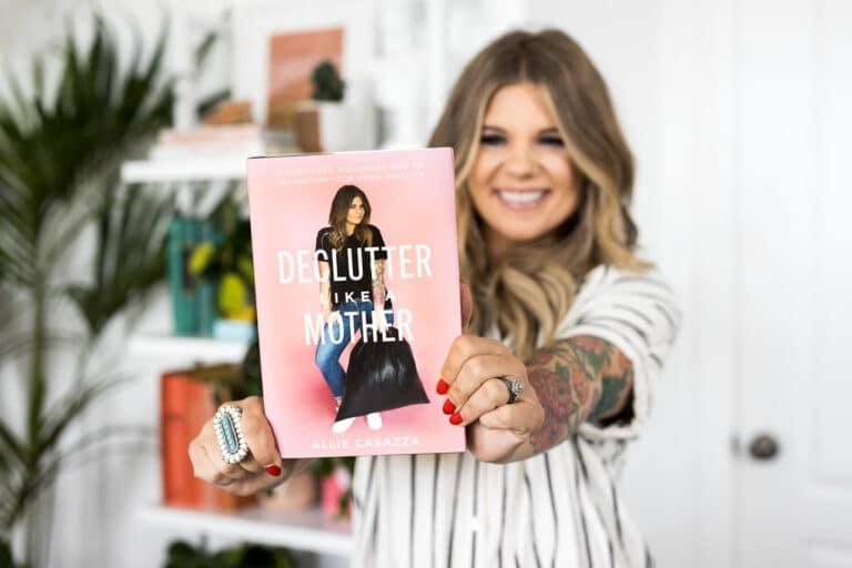 Allie Casazza holding the book Declutter Like a Mother