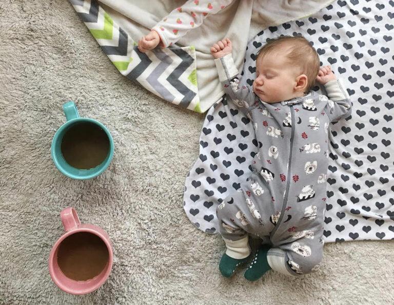 Infant lying on blanket, color photo