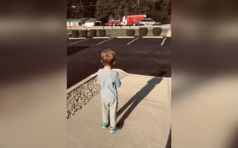 Child looking at fire truck