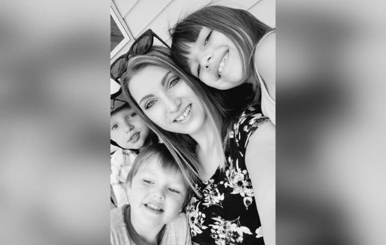 Mother and three children, black-and-white photo