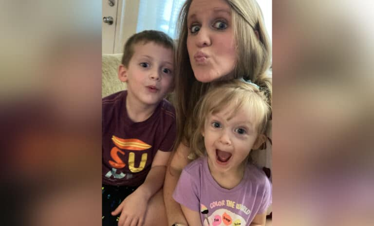 Mother and two children making silly faces, color photo
