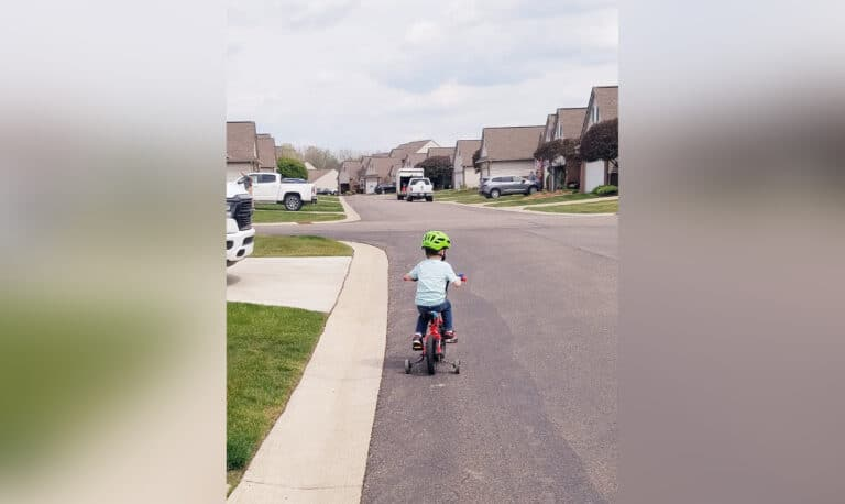 Young child on bicycle, color photo