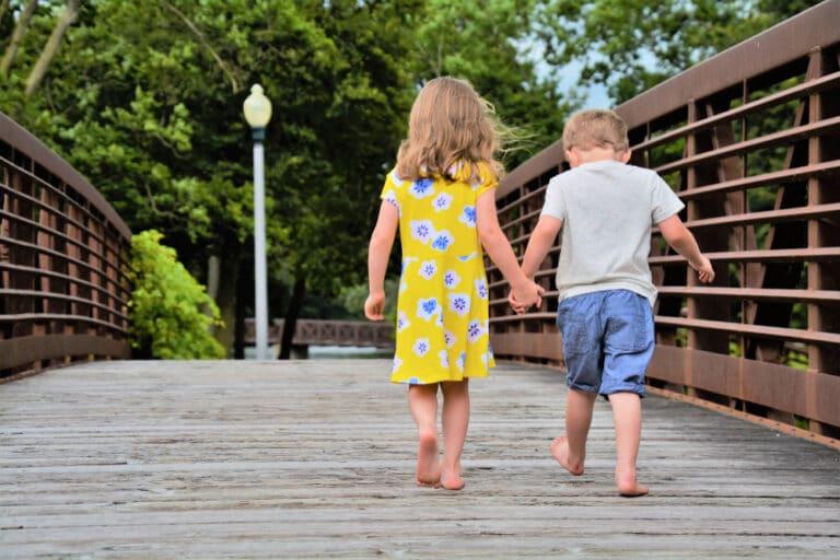 Boy and girl walk on bridge