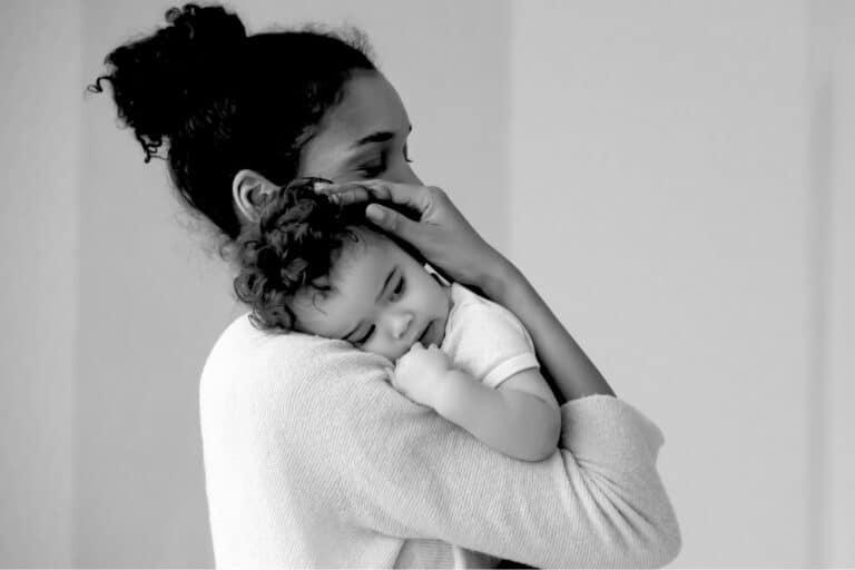 Mom holding toddler