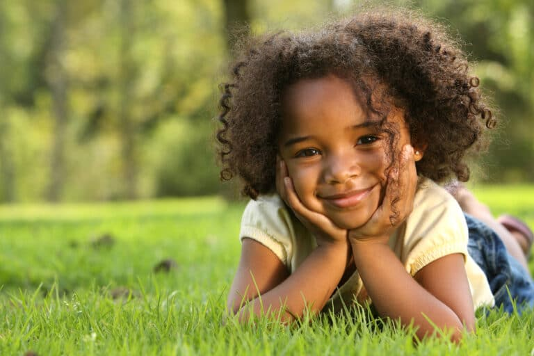 Child smiling in grass