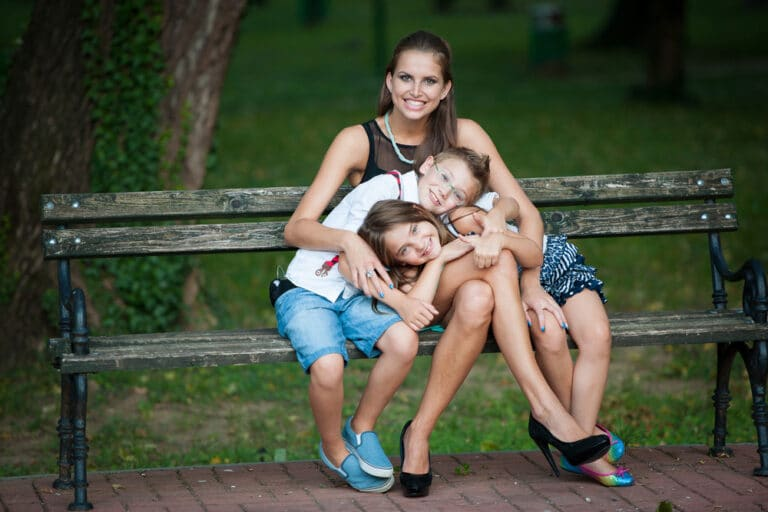 Mom and two kids on bench