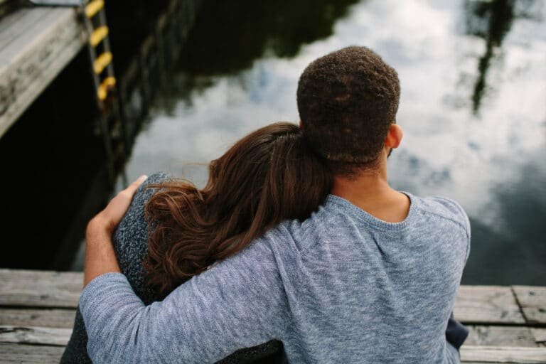 Man with arm around woman