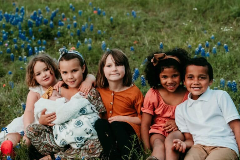 Five children and an infant, color photo