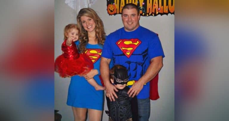 Husband and wife dressed in superhero costumes with kids, color photo