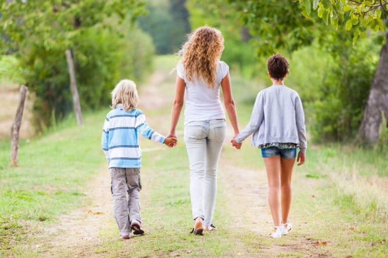 Woman walking with kids
