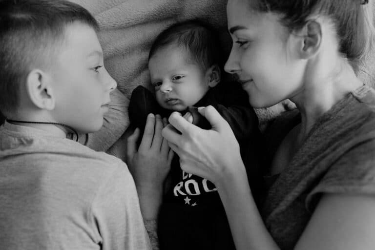 Mom and two sons black and white photo