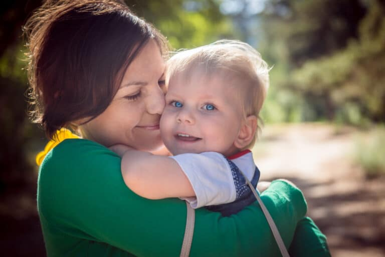 Mother hugging toddler
