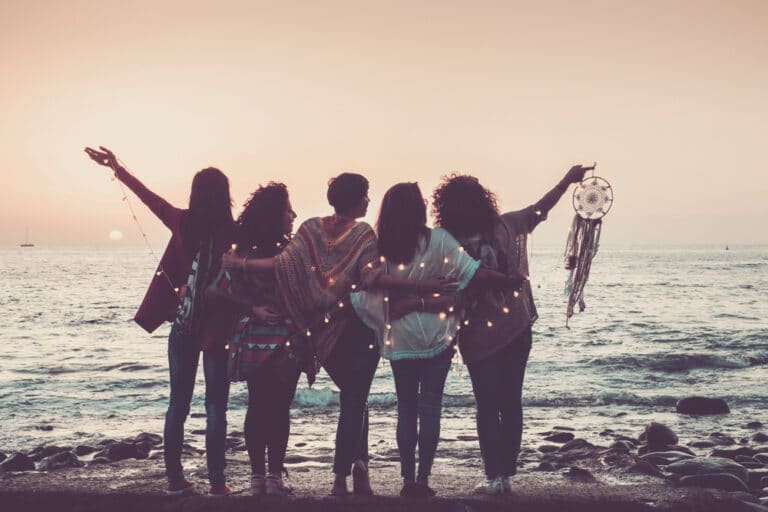 Friends at the beach sunset
