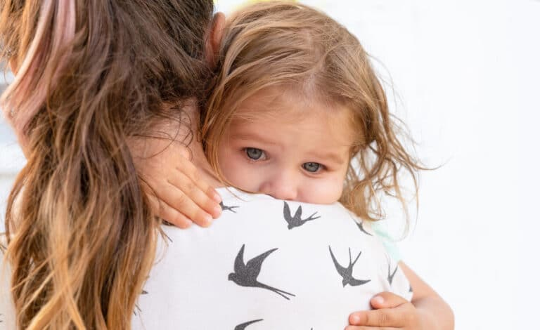 Little girl on mom's shoulder