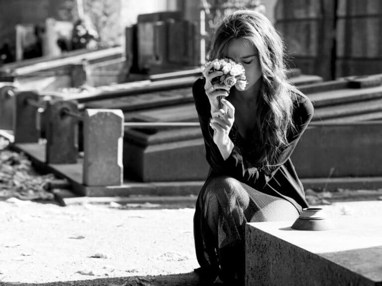 Sad woman at gravesite