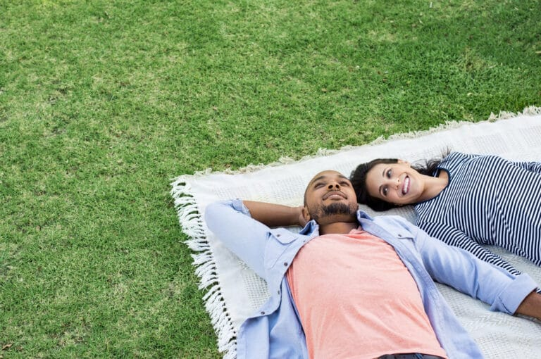 Couple on a blanket in the grass