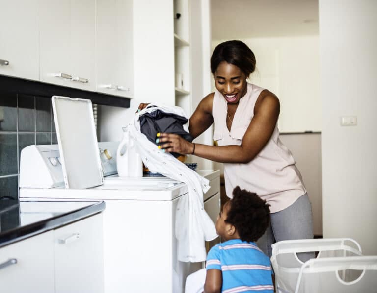 Mom doing laundry with child